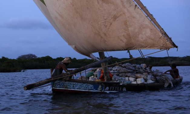 A traditional sailing dhow carries coral bricks for construction near the island of Lamu, Kenya, November 9, 2017. REUTERS/Siegfried Modola