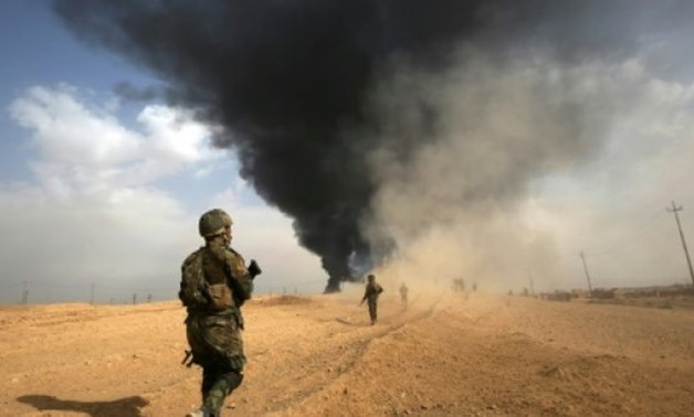 © AFP/File | Iraqi forces advance towards the town of Al-Qaim near the Syrian border on November 3, 2017 as they battle the last remnants of the Islamic State group