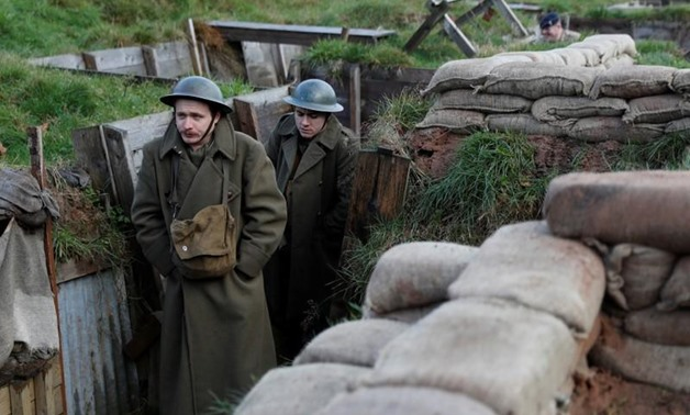 Actors Jake Morgan and Sam Ducane pose for photographs at the launch of the 1918 Poppy Pledge in a re-creation of a First World War trench at Pollock House in Glasgow, Scotland November 10, 2017. REUTERS/Russell Cheyne