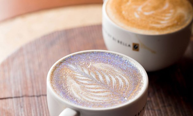 The glitter splash isn't just a topping it's actually added in before the milk and foam in order for the glitter to come from the core - Photo Via Coffee By Di Bella Facebook page
