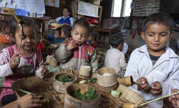 Laos: nutritious meals are bringing more children to school. Photo: World Bank/Bart Verweij