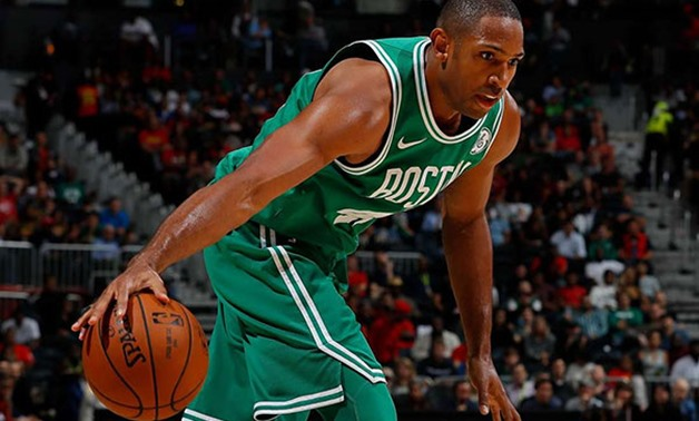 Al Horford #42 of the Boston Celtics looks to drives against the Atlanta Hawks at Philips Arena on November 6, 2017 in Atlanta, Georgia. PHOTO | KEVIN C. COX |  AFP