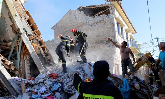 Searching for survivors in the rubble of a collapsed building in Vrissa - Reuters/Credit Giorgos Moutafis