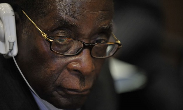 Robert Mugabe, the president of Zimbabwe, attends the 12th African Union Summit Feb. 2, 2009 in Addis Ababa, Ethiopia - wikimedia commons_U.S. Navy photo by Mass Communication Specialist 2nd Class Jesse B. A