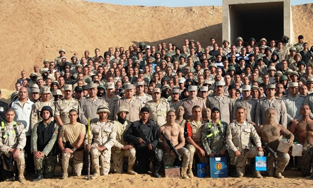 FILE – Students from different Egyptian universities, Egyptian Military Academy and Police Academy have undergone training