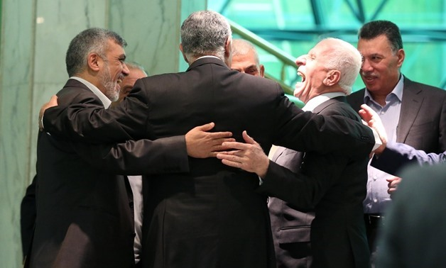 Palestinian delegations of both Fatah and Hamas rival parties after reaching a reconciliation deal in Cairo, ending a decade-long division - Photo by Essam el-Shamy/Egypt Today