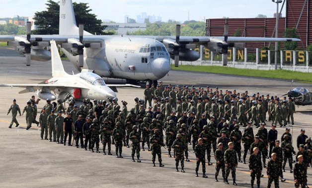 Philippines Air Force (PAF) personnel, deployed in the war-torn Marawi city, march during a Heroes' Welcome ceremony at the PAF headquarters in Pasay city, metro Manila, Philippines November 6, 2017. REUTERS/Romeo Ranoco
