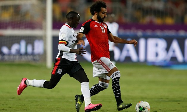 Soccer Football - 2018 World Cup Qualifications – Africa - Egypt vs Uganda - Alexandria, Egypt - September 5, 2017 Uganda's Godfrey Walusimbi in action with Egypt's Mohamed Salah REUTERS/Amr Abdallah Dalsh