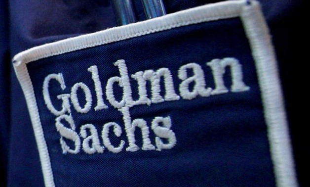 Goldman Sachs (GS) logo is seen on the clothing of a trader working at the Goldman Sachs stall on the floor of the New York Stock Exchange, United States April 16, 2012. REUTERS/Brendan
