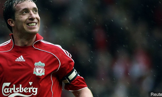 Liverpool's Robbie Fowler celebrates scoring for Liverpool - Reuters