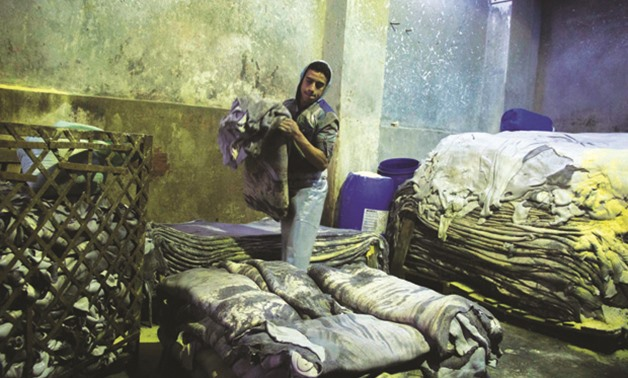 A worker at a tannery in Sour Magra El-Oyoun Street in the heart of Old Cairo - by Abdelrhman Mohamed - Egypt Today