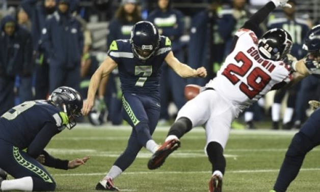 Blair Walsh of the Seattle Seahawks could have taken the game against the Atlanta Falcons to overtime but his game-tying field goal from 52 yards dropped just short - AFP/GETTY