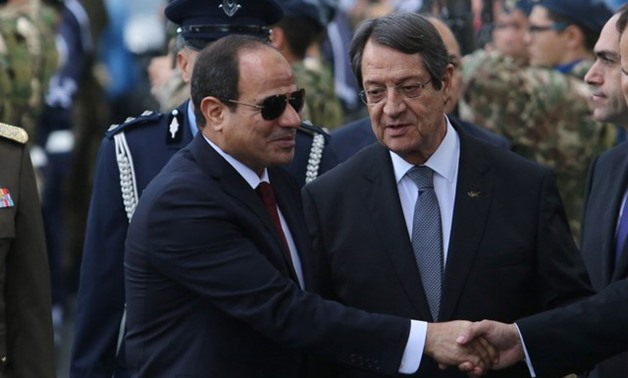 Cypriot President Nicos Anastasiades (R) and Egyptian President Abdel Fattah al-Sisi are seen during a welcome ceremony the Presidential Palace in Nicosia, Cyprus November 20, 2017. REUTERS/Yiannis Kourtoglou