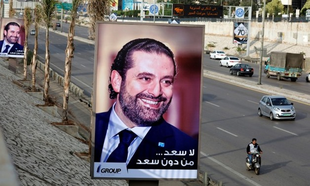 Posters depicting Saad al-Hariri, who announced his resignation as Lebanon's prime minister from Saudi Arabia, is seen at airport high way in Beirut, Lebanon November 19, 2017. REUTERS/Jamal Saidi