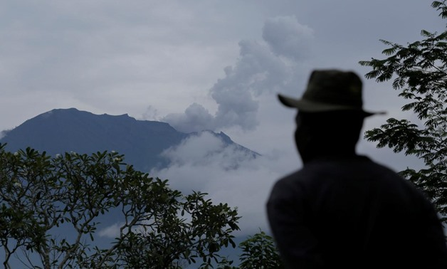 A villager looks at Mount Agung following a phreatic eruption in Rendang Village, Karangasem, Bali, Indonesia November 22, 2017. REUTERS/Johannes P. Christo