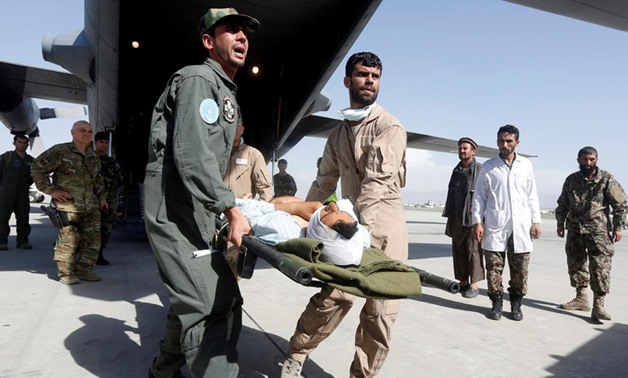 Afghan Air Force medical personnel carry an injured member of the Afghan security forces off a C-130 military transport plane in Kabul, Afghanistan July 9, 2017. (Reuters)