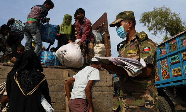 Newly arrived Rohingya refugees climb on a truck to get registered after crossing the Bangladesh-Myanmar border at a relief centre in the Teknaf area, Bangladesh, November 23, 2017. REUTERS/Susana Vera