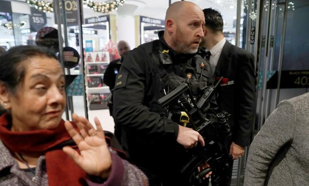 Armed police officers mix with shoppers in an Oxford Street store, in London, Britain November 24, 2017. REUTERS/Peter Nicholls