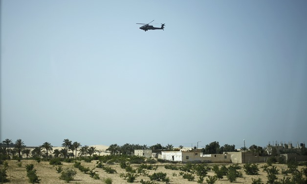 A military helicopter conducts an aerial patrol above Sheikh Zuwayed city, northern Sinai, May 25, 2015- Reuters