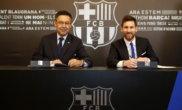 Barcelona`s president Josep Maria Bartomeu (L) with Lionel Messi (R) signing his new contract - Courtesy of FC Barcelona official website