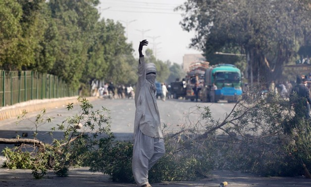 A supporter of the Tehreek-e-Labaik Pakistan, an Islamist political party, gestures after blocking the main road leading to the airport in Karachi, Pakistan November 25, 2017. REUTERS/Akhtar Soomro
