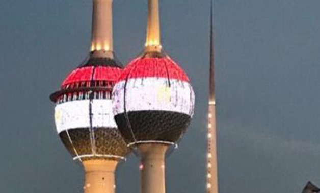 FILE - Kuwait lit its towers with lights of Egypt's flag