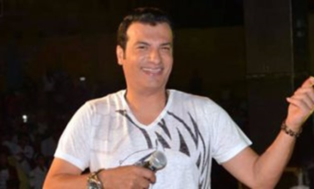 FILE – The Egyptian singer Ehab Tawfik singing in a concert
