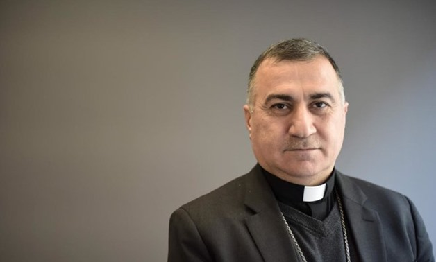 The Chaldean Archbishop of Irbil, Bashar Warda poses for a photo during an interview with AFP in Washington, DC, on Nov. 27,2017 - AFP