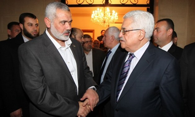 Hamas's leader Ismail Haniyeh (L) and Palestinian President Mahmoud Abbas - Press Photo