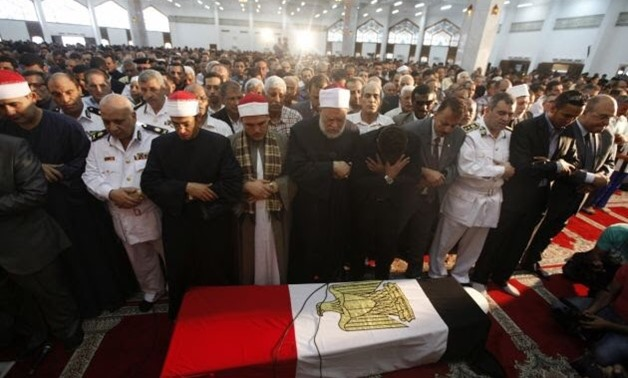 Grand Sheikh of Al-Azhar Ahmed El-Tayeb (C) prays next to Police General Nabil Farag's son (front row, head bowed) during Farag's military funeral service at Al-Rashdan Mosque in Cairo's Nasr City district September 20, 2013- Reuters
