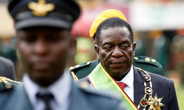 Emmerson Mnangagwa walks after he was sworn in as Zimbabwe's president in Harare, Zimbabwe, November 24, 2017. REUTERS/Siphiwe Sibeko