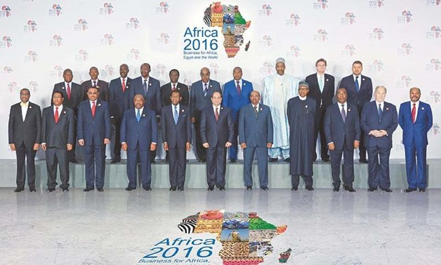 Egyptian President Abdel Fatah al-Sisi (centre) with other Heads of State and Government during Africa 2016 Forum – REUTERS