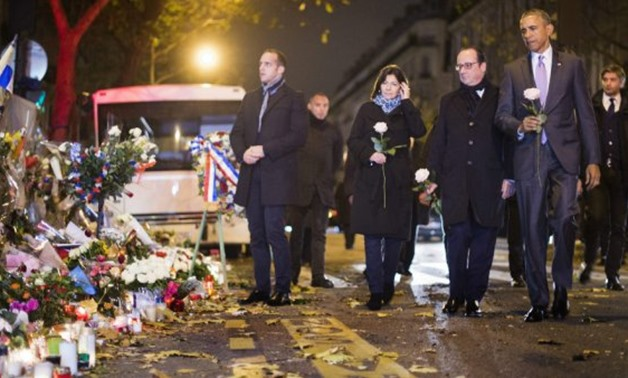 Barack Obama's visit to the French capital will reunite him with former French president François Hollande and Paris Mayor Anne Hidalgo, two years after they paid their respects to the victims of the 2015 Paris attacks - AFP/Jim Watson