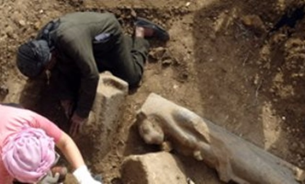 The discovery of 27 statues in Mortuary Temple of Amenhotep in Luxor - Egypt Today