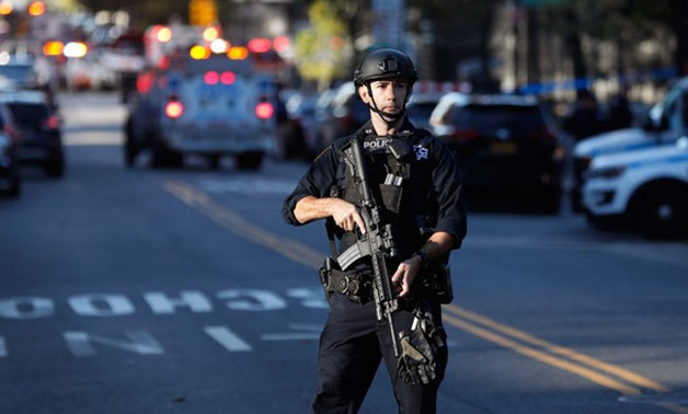 Police block off the street after a shooting incident- Reuters