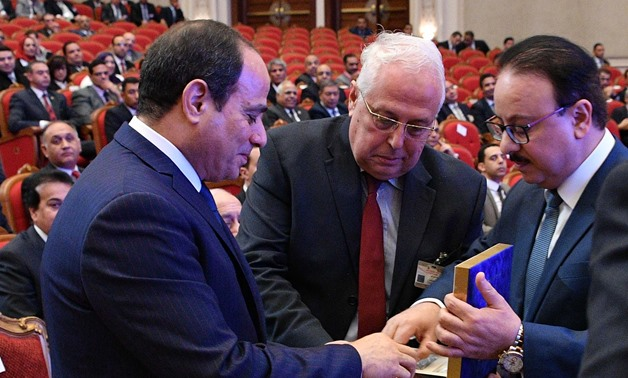 Minister of Communication Yasser El Kady handing President Sisi the first Egypt-made smart phone during Cairo ICT 2017 conference- Presidency photo