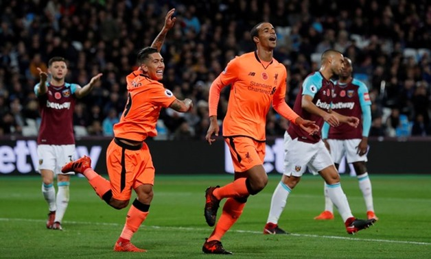 Soccer Football - Premier League - West Ham United vs Liverpool - London Stadium, London, Britain - November 4, 2017 Liverpool's Joel Matip celebrates scoring their second goal with Roberto Firmino Action Images via Reuters/Andrew Couldridge EDITORIAL