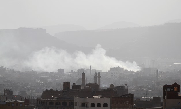 Smoke rises from areas where Houthi fighters clashed with forces loyal to Yemen's former president Ali Abdullah Saleh, who was killed, in Sanaa, Yemen December 4, 2017. REUTERS/Mohamed al-Sayaghi