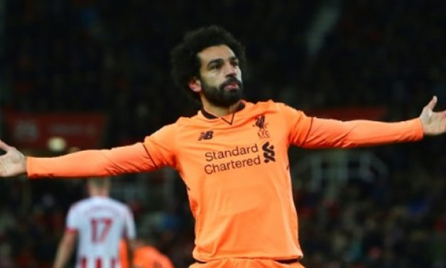 © AFP/File / by Tom WILLIAMS | Liverpool's Mohamed Salah continues to dazzle by scoring 12 goals in his first 15 Premier League appearances for the club