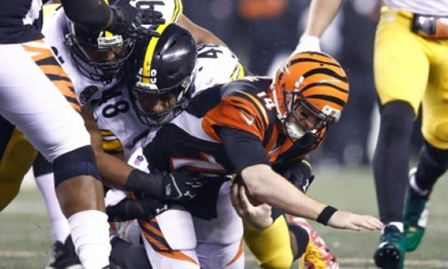 Bud Dupree (C) of the Pittsburgh Steelers sacks Andy Dalton of the Cincinnati Bengals during the second half at Paul Brown Stadium - AFP/GETTY