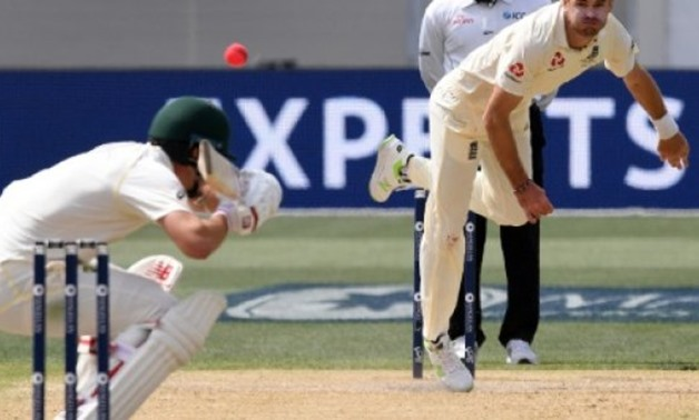England paceman James Anderson (R) sends down a bouncer to Australia's Pat Cummins on the way to capturing five wickets on the fourth day of the second Ashes Test - AFP