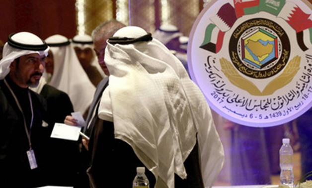 Kuwaiti and foreign journalists gather at the media centre hall during the GCC summit in Kuwait City - AFP