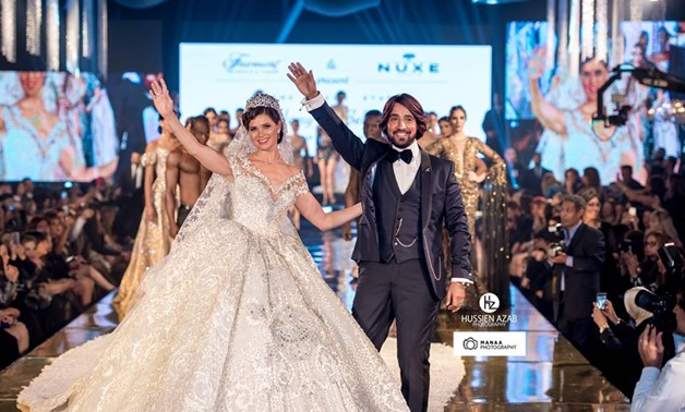 Actress Yousra El Lozy dressed in the Egypt's most expensive Egyptian wedding dress during the fashion show –Hany El-Behairy official Facebook page