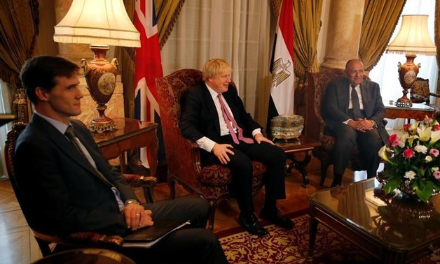 Egyptian foreign minister Sameh Shoukry (R) meets with British Foreign Secretary Boris Johnson (C) at Tahrir Palace in Cairo, Egypt February 25, 2017. REUTERS/Amr Abdallah Dalsh