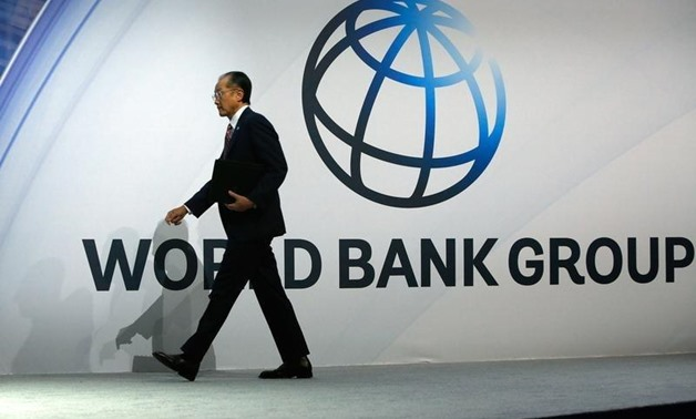 World Bank President Jim Yong Kim takes to the stage to deliver remarks at the plenary session at the IMF-World Bank annual meetings at Constitution Hall in Washington October 10, 2014. REUTERS/Jonathan Ernst