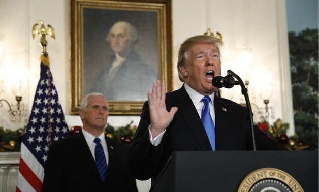 With Vice Pence Mike Pence looking on, U.S. President Donald Trump gives a statement on Jerusalem, during which he recognized Jerusalem as the capital of Israel, in the Diplomatic Reception Room of the White House in Washington, U.S., December 6, 2017. RE