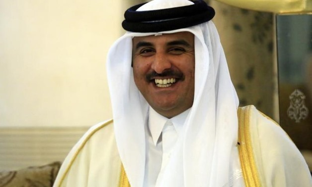 Qatar's Emir Sheikh Tamim bin Hamad al-Thani smiles as he is welcomed upon arriving at Khartoum Airport for an official visit April 2, 2014. REUTERS/Mohamed Nureldin Abdallah