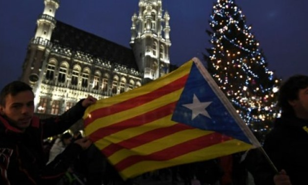 © AFP | Supporters of Catalan independence began gathering Wednesday evening ahead of a major rally Thursday
