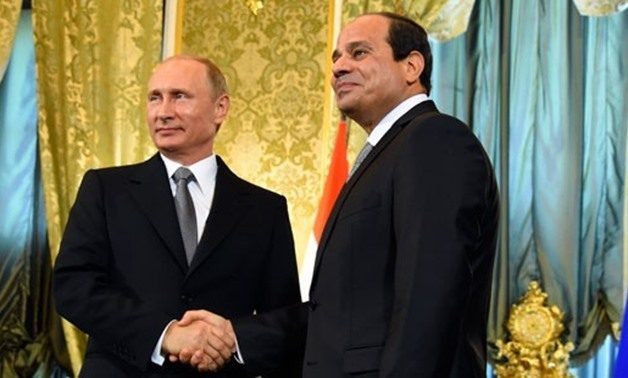 FILE - Sisi (R) welcomes Putin (L) in Egypt in November 2015