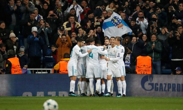 Champions League - Real Madrid vs Borussia Dortmund - Santiago Bernabeu,Madrid, Spain - December 6, 2017 Real Madrid's Lucas Vazquez celebrates scoring their third goal with team mates - REUTERS/Paul Hanna